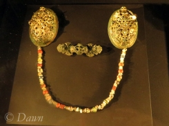 Oval brooches, beads, and an equal-armed brooch