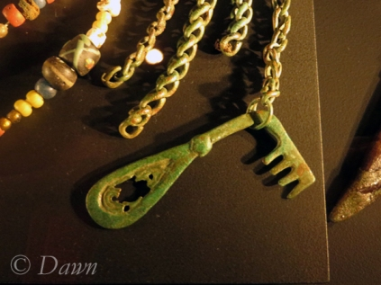 Closer view of the key hanging from a chain