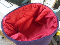 Lining the hat with red silk