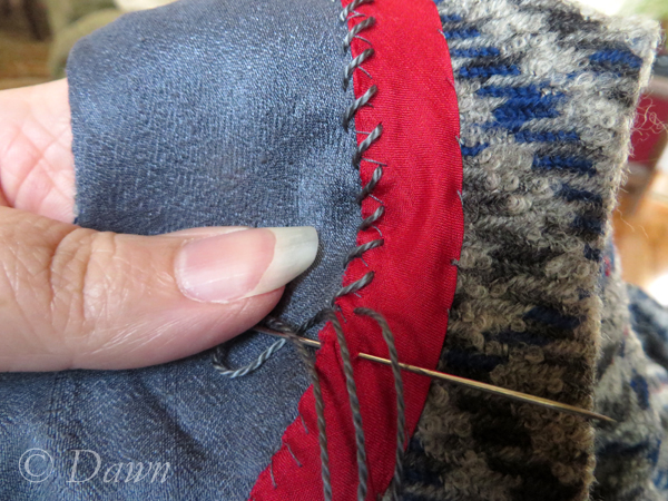 stitching with pearl cotton on the silk and wool