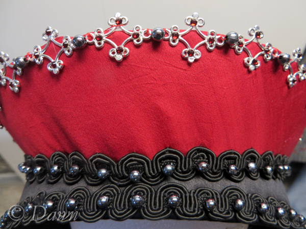 First French Hood, close up on the embellished crescent and top of base