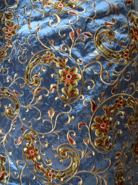 Amazing blue silk with red, green, and tan floral embroidery