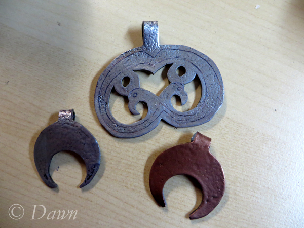 Copper pendant along with a silver one and  the bird silver embossed pendant.