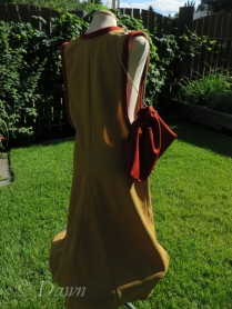 Back/side view of the yellow surcote, trimmed in red