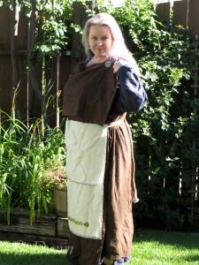 Brown wool peplos-style Finnish Iron/Viking Age worn with an embellished white apron