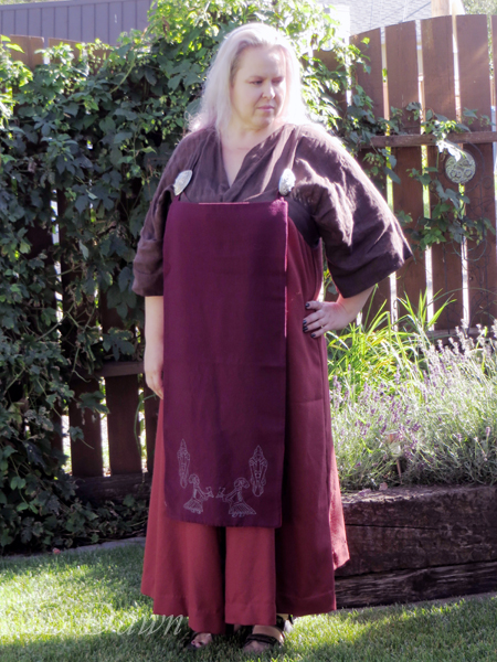 Open-front apron dress with embroidered front panel
