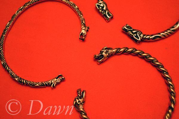 torc / torque-style animal-head bracelets/cuffs