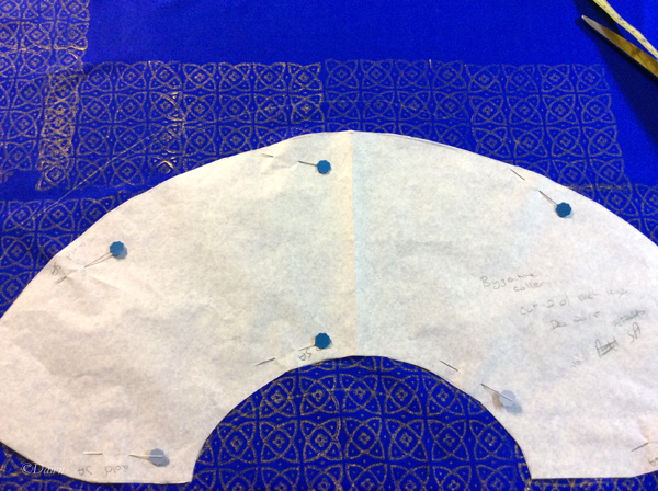 Cutting out the collar after block-printing the fabric