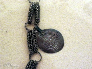 Right side of the necklace -focused on the Abbasid dirhem coin