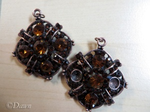 The original pendant to the left, and taking out the rhinestones on the right