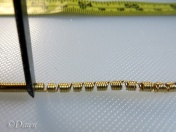Dividing a strip of coils with the chisel