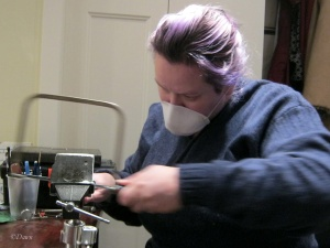 Sawing the soapstone with a coping saw