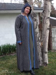 My most recent Viking-age coat in black and white wool with blue silk trim