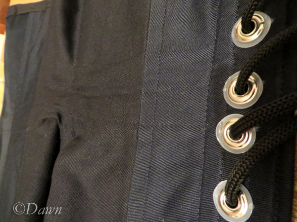 Inside of the ghost print underbust corset showing the three-piece grommets and top-stitching where the waist stay is.