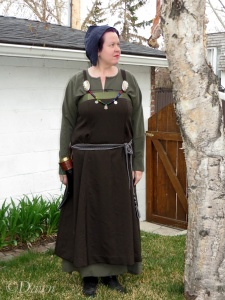Dark gren apron dress with grey-green underdress