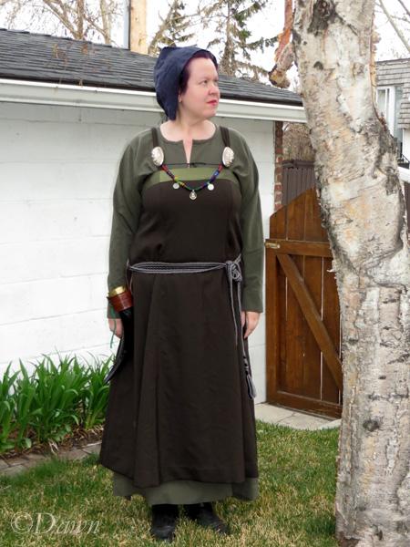 Dark green overdress worn over the drab grey-green underdress