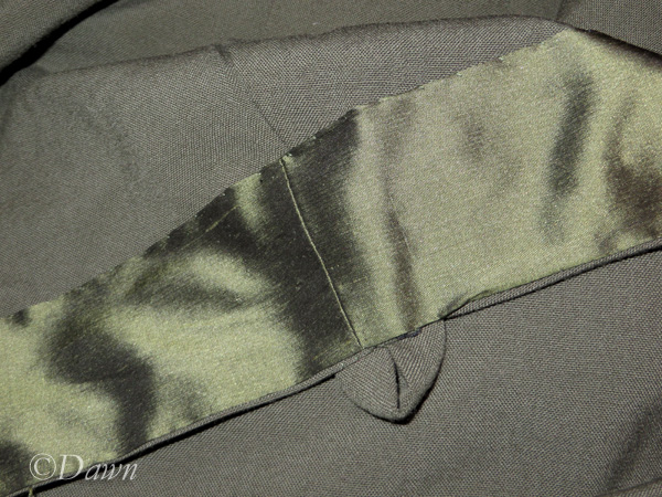 Silk trim on the drab wool apron dress