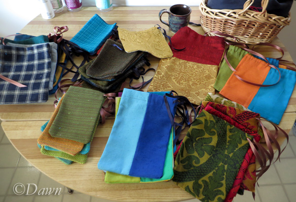 piles of 48 fabric bags and pouches