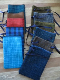 Five wool-look fold-over tie top bags (left) & Six wool-look parti-coloured drawstring bags (right)