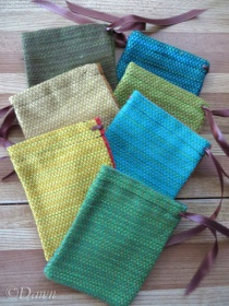 Seven hand-woven-cotton-look fabric bags one colour each side/ parti-coloured