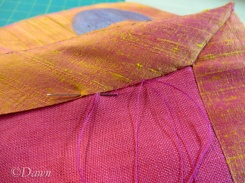 Slip-stitching the hem facing to the lining