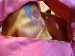 stitching the armhole closed by hand