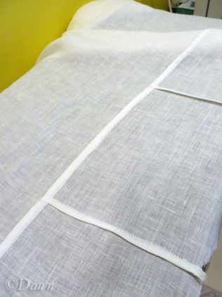 Pressing the finished seams on the camicia
