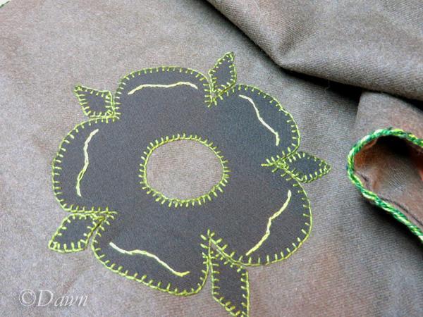 Flower in green wool on green wool