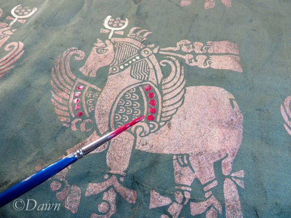 Painting in some of the details on the silk