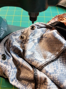 Installing grommets into the snakeskin dress using my press