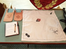 Leather hip protectors and an embroidered napkin work-in-progress by Skeld