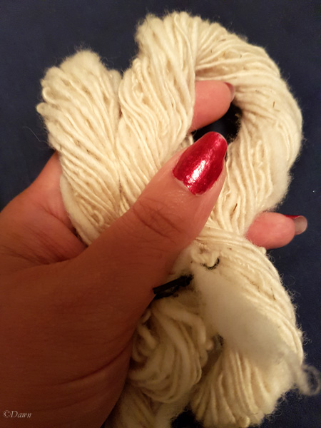 "Natural ""white"" wool yarn. The wool batt was fluffy, but I tried to use the ""worsted"" spinning technique to create a smoother yarn."