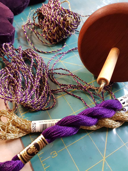 Using my drop-spindle to make gold and purple cord