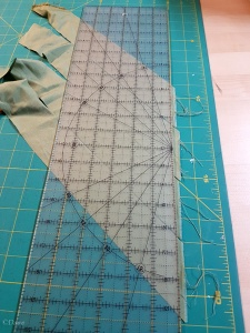 Trimming bias strips for binding the bodice out of matcha-green silk broadcloth
