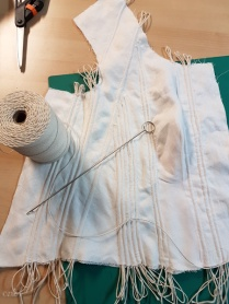 Channels in the front of the bodice lining/interlining stuffed with butcher's cord