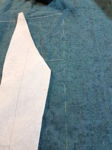 Basting the centre of the design on the fabric to line up the bodice back