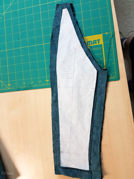 Cutting the center back - note the different seam allowances on the centre back seam, waist seam, side-back seam, shoulder seam, and the neckline.