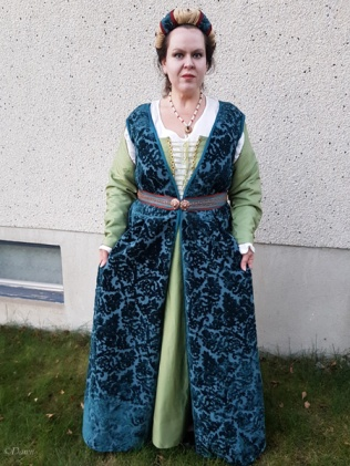 "The complete ""Celebration"" Italian outfit from the front, holding the over-dress open to show the silk skirt under it."