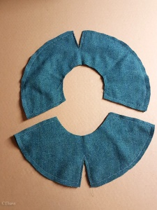 The fronts and backs of the split-brim hat sewn together.