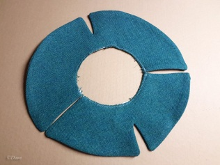 The constructed brim of the split-brim hat sewn into a circle.