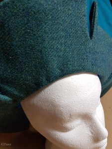 The edge of the split-brim hat turned in and pressed. Shown on a (too small) foam head.