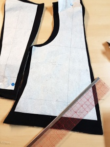 Cutting out my bodice pattern for my Cranach gown costume, from black wool.