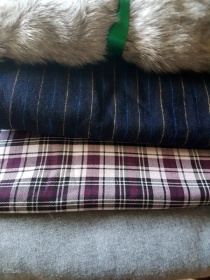 Faux fur, wool stripes, and synthetic-blend plaid, along with some wool lightweight coat fabric from the Grandmother's Fabric sale 2017
