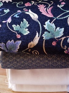 Black floral upholstery fabric, blue and gold upholstery/home dec fabric and two cuts of off-white cotton canvas - Grandmother's Fabric sale 2017