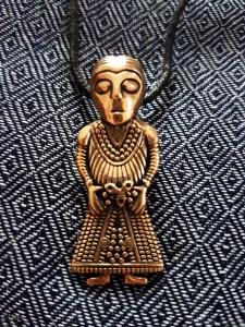 Female figure pendant from Historiska Fynd