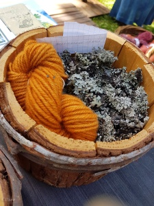 Orange wool yarn dyed with lichen at the Medieval Market in Turku