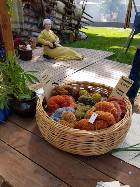 A basket full of various coloured yarns dyed with natural dyes.