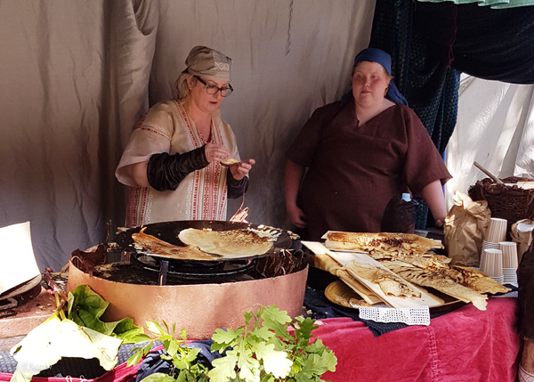 A vendor with pancake or flatbread - not sure