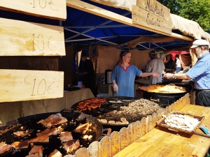 Very large skillets with a variety of food for sale at the Turku Medieval Market
