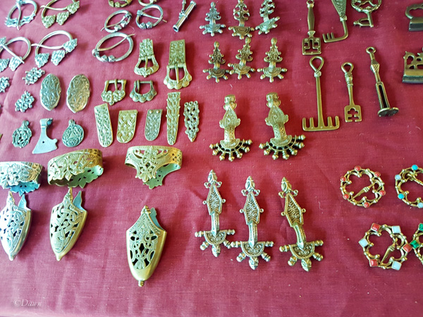Sword scabbard fittings, brooches, and belt fittings from another vendor at the Turku Medieval Market.